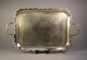 ELECTROPLATED TWO HANDLED LARGE TEA TRAY, of rounded oblong form with foliate scroll chased centre