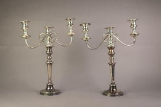 PAIR OF 20th CENTURY ELECTROPLATED CANDLESTICKS with removable three-light twin branch reflex candle