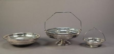 TWO ELECTROPLATED SWING HANDLED BASKETS WITH PIERCED BORDERS, the smaller with a MATCHING FOOTED