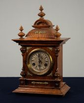 EARLY TWENTIETH CENTURY CARVED WALNUT MANTLE CLOCK, the 4? Roman dial with scrolled centre,