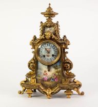 LATE NINETEENTH CENTURY GILT BRASS MANTLE CLOCK WITH HAND PAINTED SEVRES STYLE PORCELAIN PANELS, the