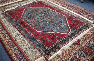 PERSIAN WOOL RUG, with octagonal large centre panel with all-over scattered design of stylized
