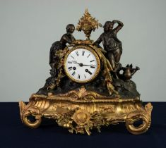 FRENCH LATE NINETEENTH CENTURY SPELTER AND PARCEL GILT MANTEL CLOCK, with eight days movement
