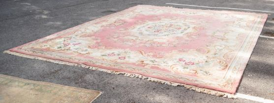 LARGE INDIAN WOOL PILE BORDERED CARPET of Aubusson design with multicoloured flowers, cream and