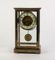 EARLY TWENTIETH CENTURY BRASS FOUR GLASS MANTLE CLOCK, of typical form with matted centre to the