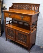 ARTS AND CRAFTS CARVED OAK AND POLLARD OAK TWO TIER BUFFET, the top with floral carved panel to