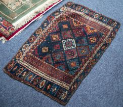 SHIRAZ RUG, with all-over diamond shaped tile pattern, the principal border white with repeat double