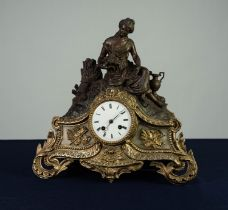 FRENCH LATE NINETEENTH CENTURY AND PARCEL GILT METAL CLOCK with 8 day movement striking on a domed