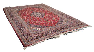 KASHAN PERSIAN CARPET, with lozenge shaped centre dark blue and floral medallions with pendants