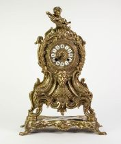 CAST BRASS LARGE MANTLE CLOCK IN THE ROCOCO TASTE, the twelve piece 4? Roman dial powered by a