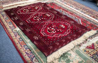 IRANIAN BALOUCHI HAND KNOTTED WOOL RUG, with tulip large medallion pattern on a wine red field