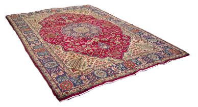 TABRIZ PERSIAN CARPET, with blue and floral shaped circular centre medallion with pendants on a