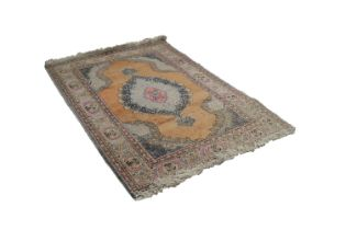 EASTERN RUG, with lozenge shaped centre medallion with pendants on plain salmon pink field