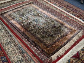 EASTERN PART SILK FINELY KNOTTED RUG, with centre lozenge shaped medallion with pendants on a