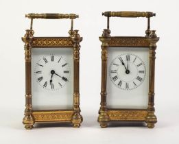EARLY TWENTIETH CENTURY PAIR OF GILT BRASS CARRIAGE CLOCKS, each with white enamelled Roman dial,