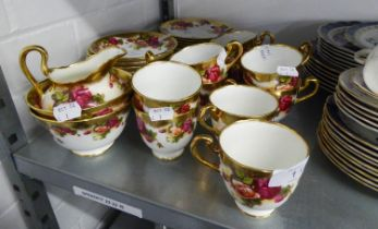 A ROYAL CHELSEA 'GOLDEN ROSE' PATTERN TEA SERVICE OF 39 PIECES