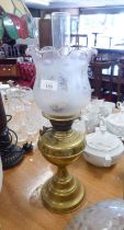 A BRASS OIL LAMP WITH OPALINE GLASS SHADE AND FUNNEL