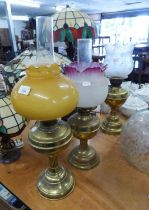 """TWO CLOSELY MATCHED BRASS OIL LAMPS, WITH GLASS SHADES AND FUNNELS, 22"""" HIGH AND SLIGHTLY SMALLER ("""