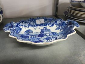 AN EARLY NINETEENTH CENTURY STAFFORDSHIRE BLUE AND WHITE TWO HANDLED OVAL DISH WITH BOUCHER AND