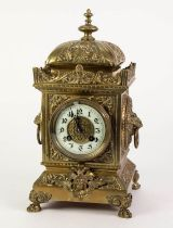 EARLY TWENTIETH CENTURY EMBOSSED BRASS MANTLE CLOCK BY JAPY FERES, the 4? Arabic dial powered by a