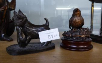 BRONZE SMALL MODEL OF A ROBIN, and a PATINATED COMPOSITION MODELS OF A SCOTTIE DOG with tam o
