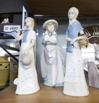NAO, SPANISH PORCELAIN, GIRL CARRYING TWO PUPPIES AND TWO FIGURES IN SIMILAR TASTE (3)