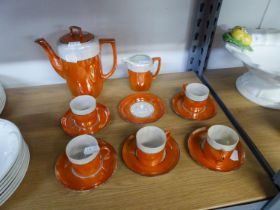 AN ORIENTAL PORCELAIN ORANGE AND OPALESCENT LUSTRE COFFEE SERVICE OF 13 PIECES; BOXED AYNSLEY