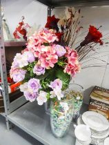 THREE LARGE GLASS VASES, AND A SELECTION OF FABRIC DISPLAY FLOWERS