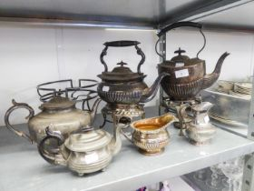 TWO ELECTROPLATE SPIRIT KETTLES ON STANDS WITH SEMI GADROON DECORATION, ONE BEING OVAL, THE OTHER