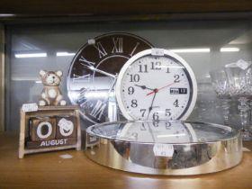 A MIRROR GLASS CIRCULAR QUARTZ WALL CLOCK; A WOODEN PERPETUAL CALENDAR WITH TEDDY BEAR