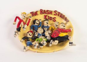 HOWARD GORST (b.1955) PAINTED OVAL CERAMIC PLAQUE, MODELLED IN RELIEF ?The Bash Street Kids? 9? x