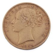 A Victorian shield back sovereign dated 1864