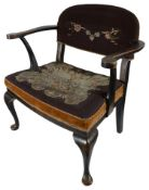 An early 20th century japanned black lacquer and gilt chinoiserie open armchair