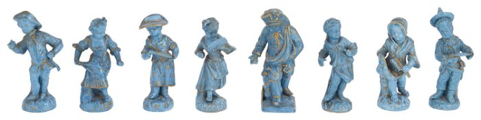 A collection of eight 19th c. Continental turquoise glazed and gilt decorated porcelain figures