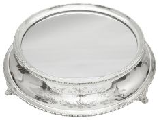 A mid 20th century electroplated circular mirror plateau or wedding cake stand