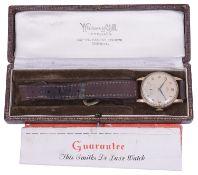 A gentleman's 9ct gold Smiths mechanical strap watch