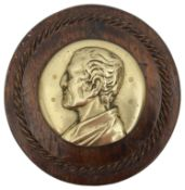 A 19th century circular brass relief profile plaque of the Duke of Wellington