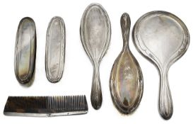 A George V silver six piece dressing table set