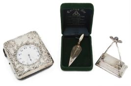 A late Victorian embossed silver and leather travel watch case; others