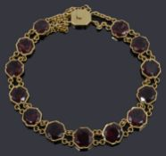 An early 20th century garnet and yellow gold flexible line bracelet