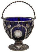 A Victorian silver wirework swing handled sugar basket