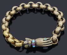 A Regency gold guard chain with gem set gloved hand clasp