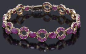 A gold ruby set line bracelet