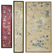 Three framed and glazed Chinese textiles