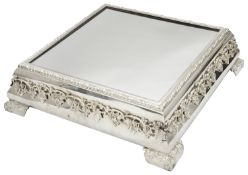 A large mid 20th century electroplated square mirror plateau or wedding cake stand