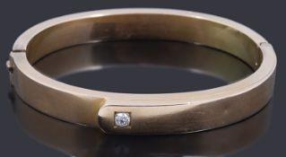 A gold single stone diamond hollow hinge bangle