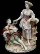 A late 19th/early 20th century porcelain figure group