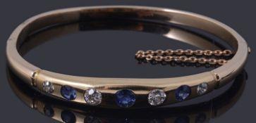 A gold sapphire and diamond hinge bangle