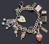 A 9ct gold charm bracelet with padlock and assorted charms