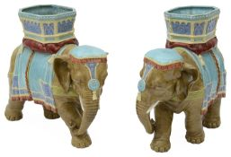 A pair of Victorian Royal Worcester majolica glazed elephants